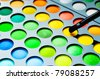 Palette of colorful eye shadows with brash - stock photo