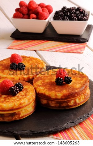 Pancakes with syrup and fruits of the forest
