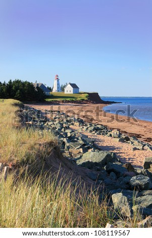 Panmure Island lighthouse in the Atlantic shore of Prince Edward Island, Canada at sundown