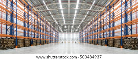 Panorama of an empty huge distribution warehouse with high shelves and pallet