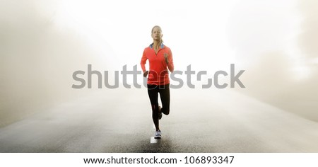 Panorama of athlete running outdoors on a road training and exercising for a marathon endurance sport.