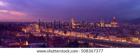 Panorama of famous Florence city and river Arno after sunset with night illumination, Tuscany, Italy, Europe. Travel outdoor sightseeing background.