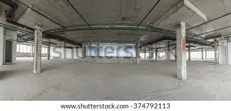 Panorama of interior of business center under construction. With communication pipes on ceiling and exit doors