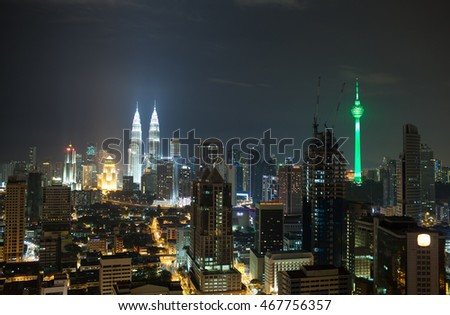 Panorama of Kuala Lumpur at night. Illuminated buildings and skyscrapers in the capital of Malaysia. Menara KL Tower and Petronas Towers dominating over the city architecture