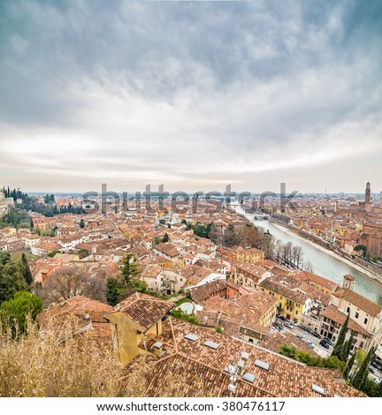 panorama of the Adige River as it passes through the houses and historical buildings of Verona in Italy, known as romantic city of love because Romeo and Juliet by Shakespeare was set here