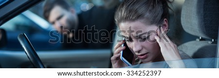 Panorama of unaware woman talking on phone and hiding criminal