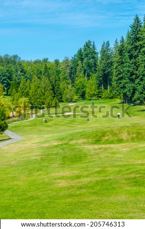 Panorama, outlook at the beautiful golf course  in a sunny day. Canada, Vancouver. Vertical.