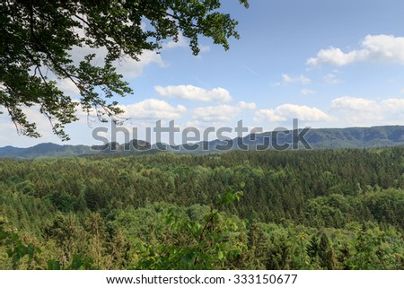 Panorama with rocks, mountains and forest seen from Kuhstall in Saxon Switzerland