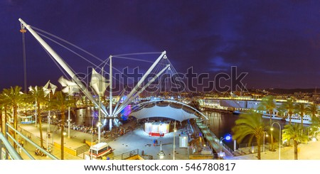 Panoramic elevator Bigo in the ancient port of Genoa on Mediterranean Sea, at night, Italy.