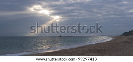 panoramic landscape of a beach on sunset