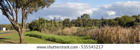 Panoramic view from the cycleway near Big Swamp, Bunbury Western Australia on a late afternoon in early winter.