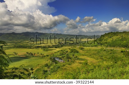 Panoramic view of rural landscape with tropical vegetation on cuban countryside - sierra del escambray, trinidad