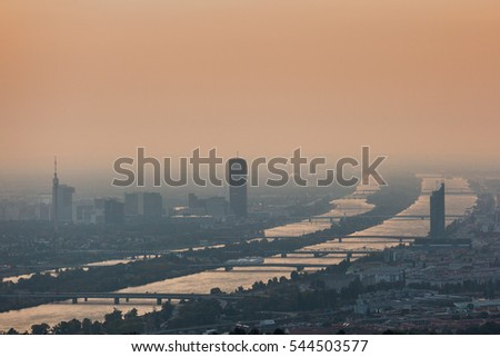 Panoramic view of Vienna city and Danube arms from Kahlenberg hills at sunrise with fog. Picture taken in October 2016
