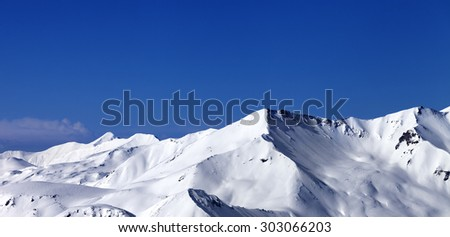 Panoramic view on off-piste snowy slope at sunny day. Caucasus Mountains, Georgia, ski resort Gudauri.