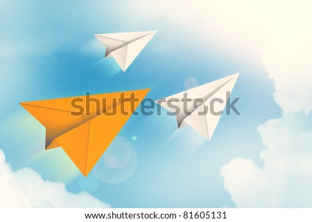 Paper airplanes flying through the air