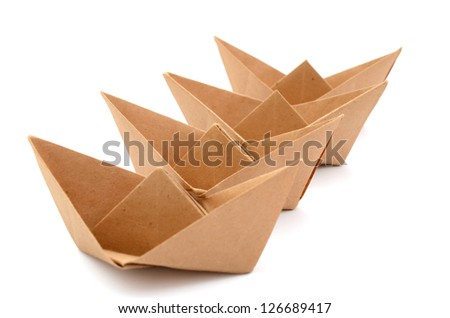 Paper boats on row