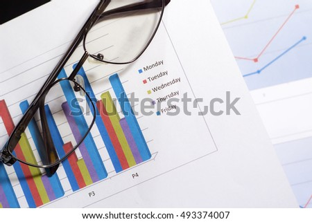Paper business chart and eyeglasses