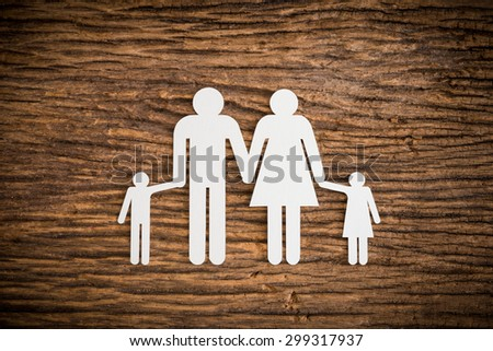 paper chain family symbolizing on wooden background. love family concept