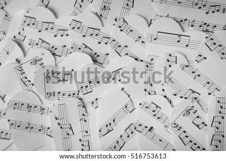 Paper hearts with music notes background