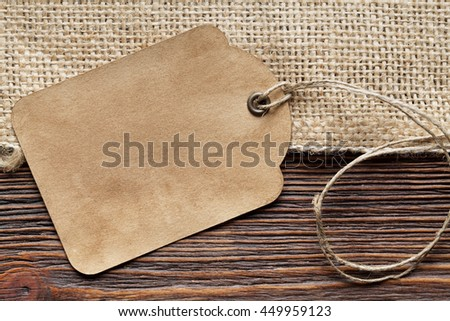 Paper label, wood and jute fabric
