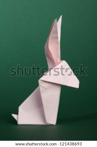 Paper made pink rabbit. 3D folded origami style.