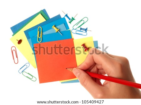 Paper notes in different colors with hand writing