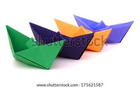 Paper ships on a white background