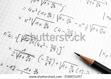 paper with maths-formulas and a pencil - homework concept