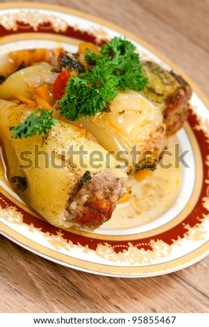 Paprika  stuffed   mincemeat, on plate and parsley