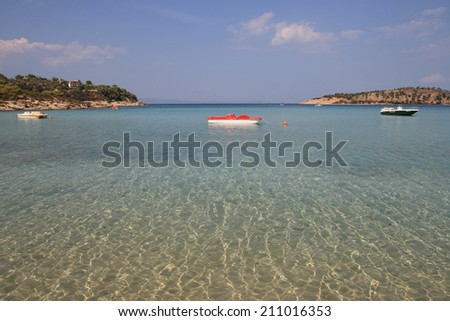 Paradise bay beach with clear water of the sea (Lagonisi beach , Sithonia peninsula Halkidiki, Greece )