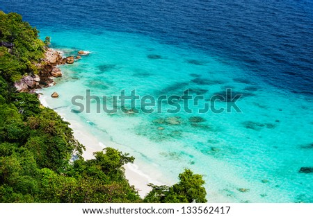Paradise beach with white sand and clear blue turquoise water