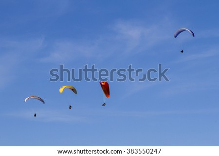 Paraglider flying on a sunny day