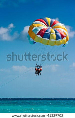 Parasailing in beach in summer