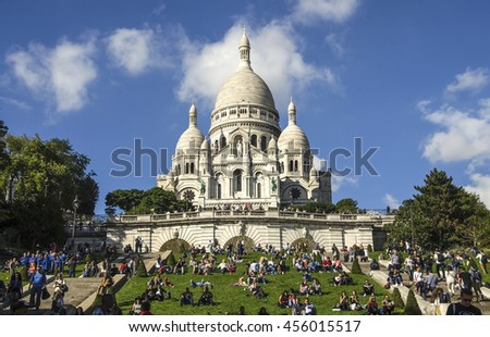 PARIS, April 2015:The Basilica of Sacre Coeur in Paris, France. Basilica is a famous catholic church in Paris. It is located at the highest point in the city.