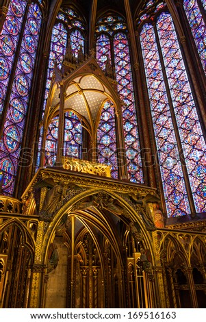PARIS - DECEMBER 24, 2013: Interiors of the Sainte-Chapelle (Holy Chapel) on December 24, 2013. The Sainte-Chapelle is a royal medieval Gothic chapel in Paris and one of the most famous monuments of the city