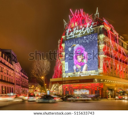 PARIS,DECEMBER 21: Night aspect of Galleries Lafayette and The Haussmann Boulevard decorated for winter holidays in Paris on December 21, 2014.