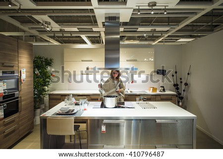 cook on kitchen prepares meal stock photo 17823949 shutterstock. Black Bedroom Furniture Sets. Home Design Ideas