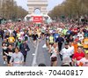 PARIS, FRANCE - APRIL 6: Group of runners start on Champs Elysees  the Paris Marathon, April 6, 2008 in Paris, France - stock photo