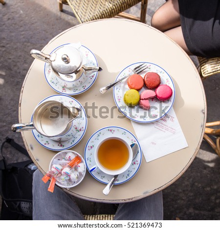 Paris, France - April 21, 2016: The couple is  having breakfast with cookies and tea