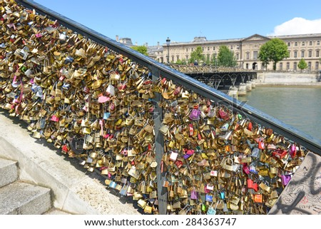 PARIS FRANCE. CIRCA MAY 2015. Paris started removing love locks from the Pont des Arts Bridge as their collective weight could cause the bridge to collapse, endangering visitors and ferry passengers.