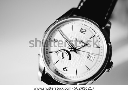 PARIS, FRANCE - JAN 30 2014: Black and white Detail of Hamilton swiss made watch against white background. The Hamilton Watch Company is a brand of the Swatch Group, a Swiss watch company