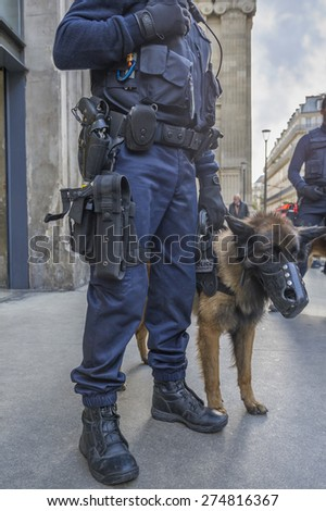 PARIS, FRANCE - JANUARY 11, 2015 : French Police dog trainer patrolling for plan vigipirate against attack terrorist