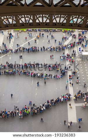 Paris, France, May 2, 2013 . Tourists stand in line at the Eiffel Tower