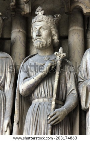 PARIS, FRANCE - NOV 11, 2012: King Salomon statue, Church of St-Germain-l'Auxerrois founded in the 7th century, was rebuilt many times over several centuries.