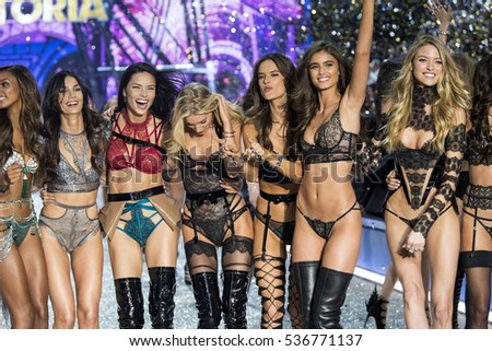 PARIS, FRANCE - NOVEMBER 30: Models pose on the runway during the 2016 Victoria's Secret Fashion Show on November 30, 2016 in Paris, France.