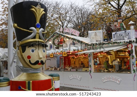 PARIS, FRANCE, November 15, 2016 : The Paris Christmas market opens on Champs-Elysees Avenue. The history of Christmas markets goes back to the Late Middle Ages in the German-speaking part of Europe.