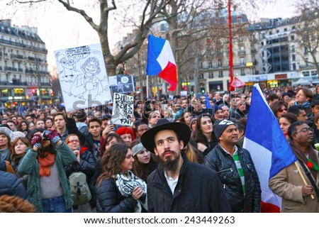 PARIS - France on 08 January 2015 : Peaceful protest in Place de la Republique against the terrorist attack on Charlie Hebdo journal, promoting freedom of speech