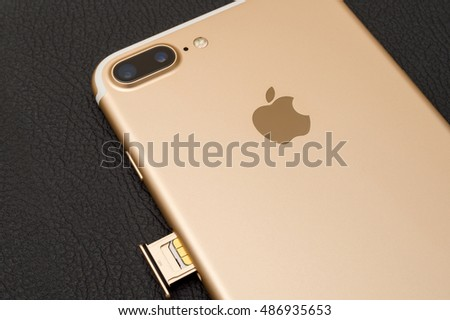 PARIS, FRANCE - SEP 16 2016: New Apple iPhone 7 Plus unboxing in the first day of sales - iinsering SIM card in new phone. New Apple iPhone acclaims to become the most popular smart phone in the world