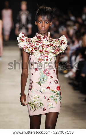 PARIS, FRANCE - SEPTEMBER 30: A model walks the runway during the Andrew GN show as part of the Paris Fashion Week Spring/Summer 2017 on September 30, 2016 in Paris, France.