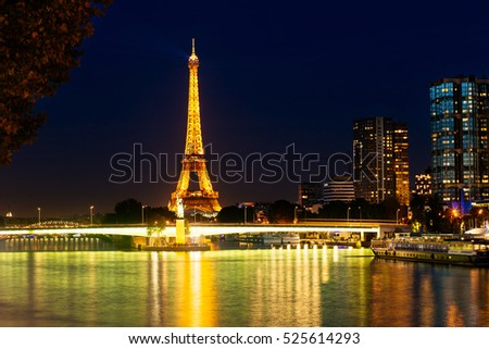 Paris, France - SEPTEMBER 2016. Eiffel Tower in night. Famous historical landmark on the quay of a river Seine. Romantic, tourist, architecture symbol. Toned